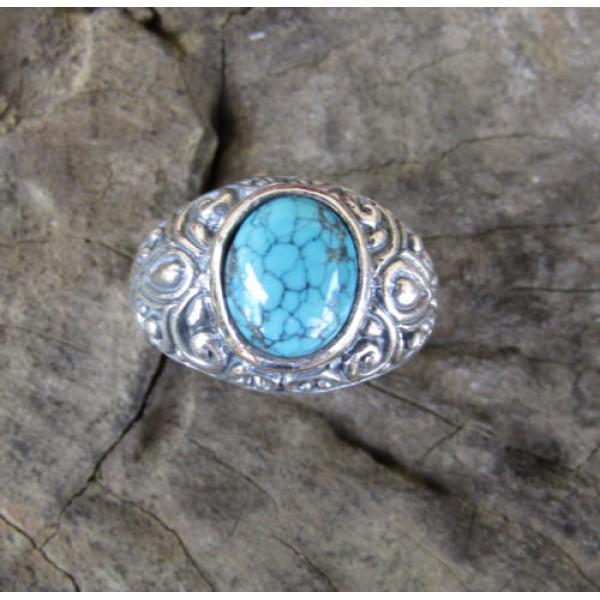 Silver ring bun carving motif turqoise