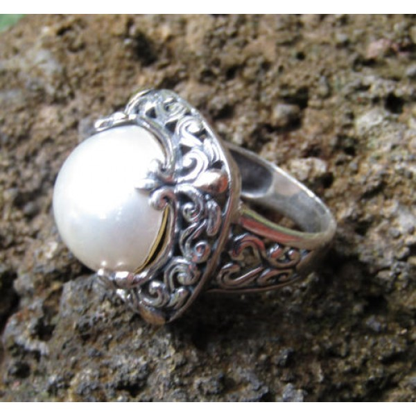 silver ring leaf motifs carved stone mabe